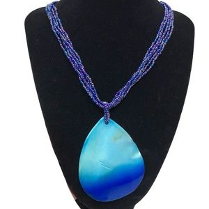 BLUE SEED BEAD NECKLACE WITH SHELL PENDANT